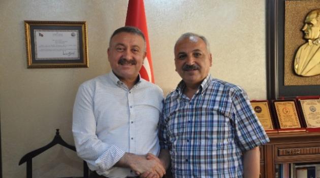 Milletvekili Özkan'dan Esnaf Temsilcisi Dinçer'e Demokrasi Nöbeti Teşekkürü